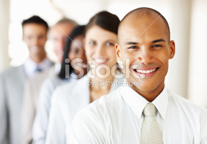 stock-photo-17262753-young-business-man-with-colleagues-in-the-background